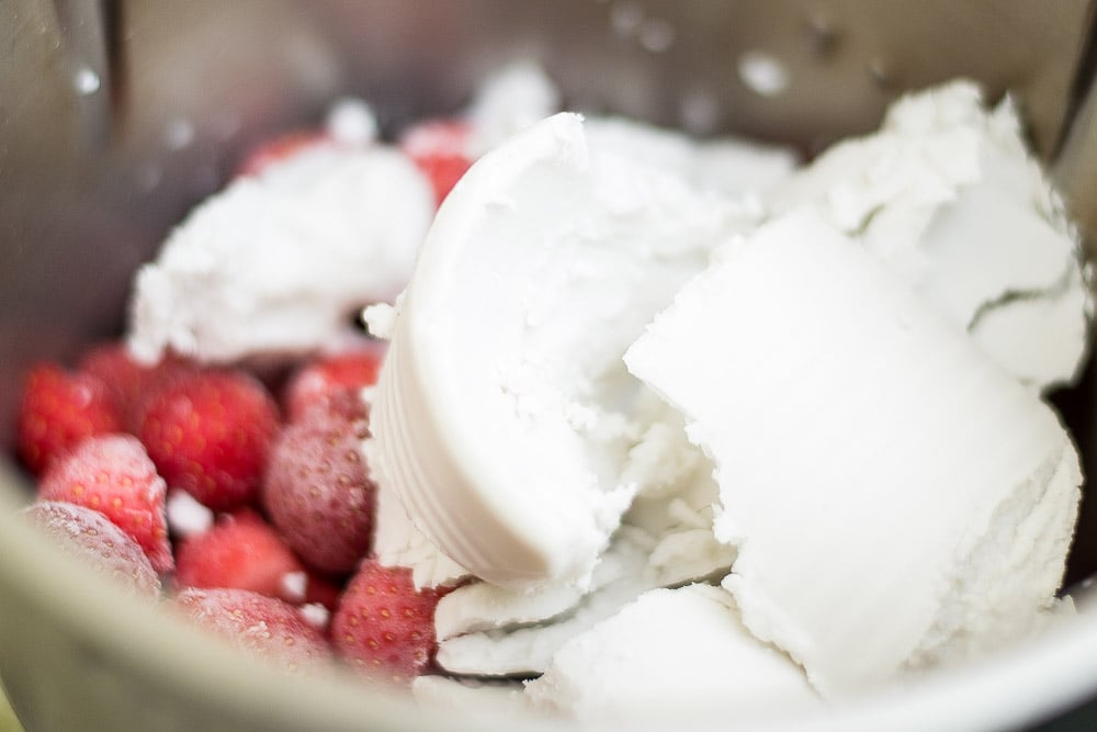 Adding coconut cream to strawberries