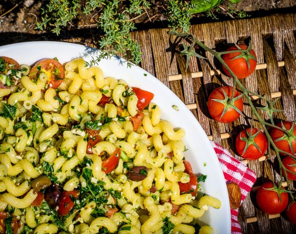 Pasta with rocket pesto, cherry tomatoes and olives