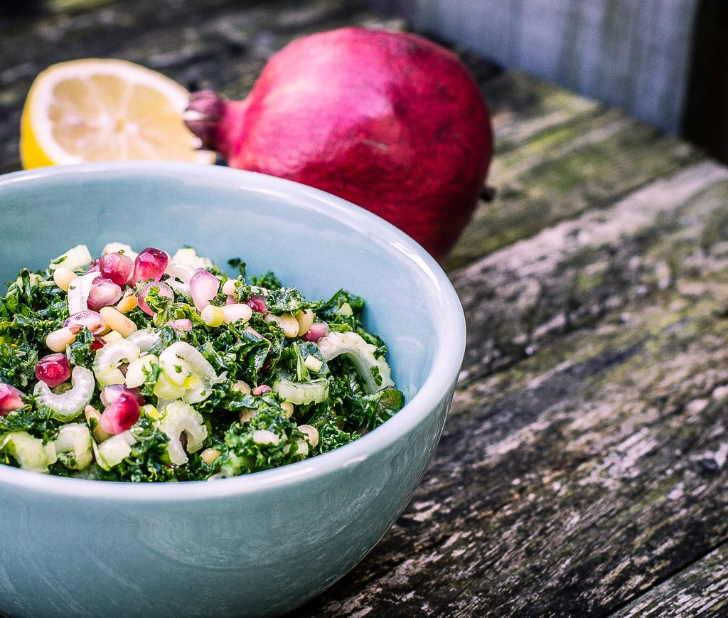 Festive kale salad with pomegranate and pinenuts