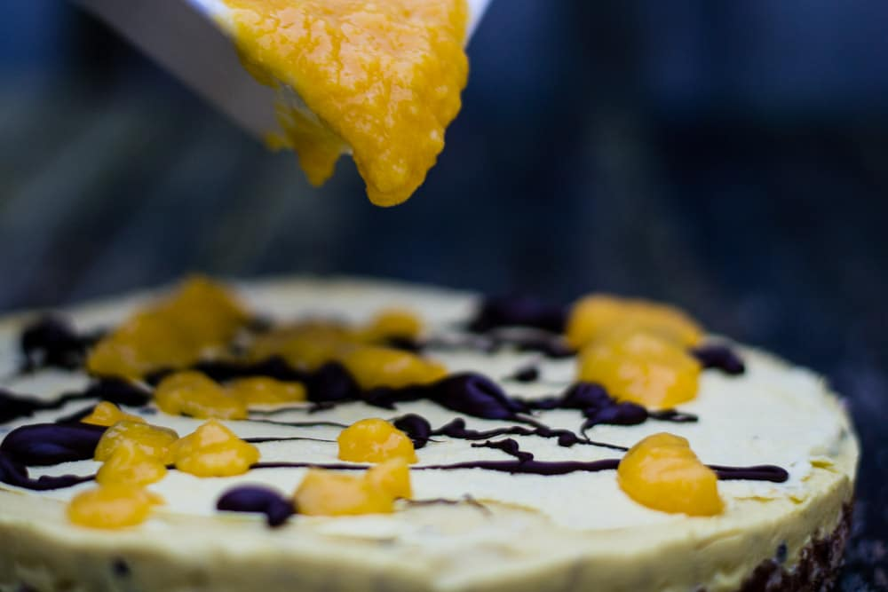 Mango puree on top of the vegan mango ice cream cake
