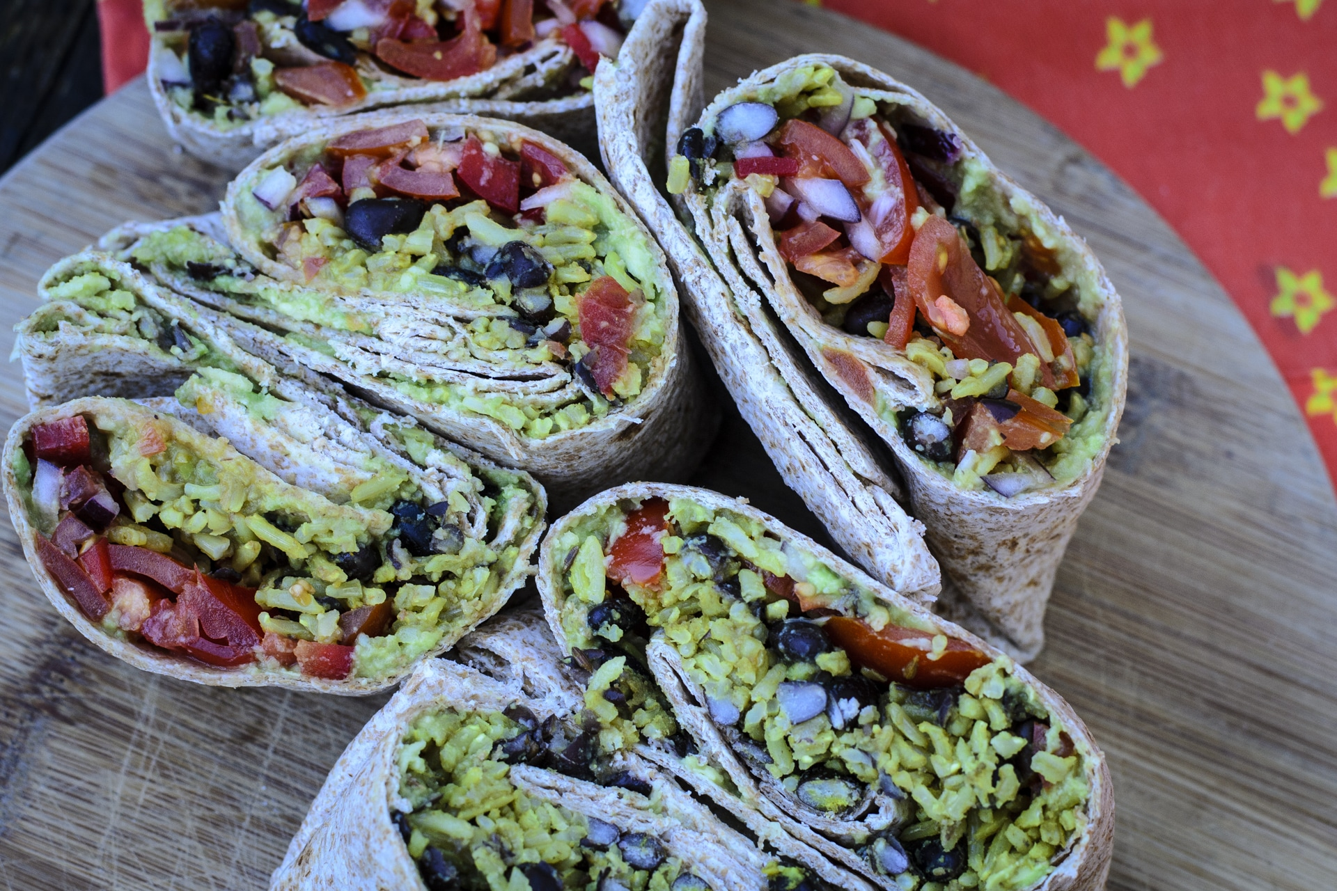 Vegan burritos recipe: tortilla wraps, rice, black beans, avocado, veggies